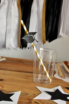 I HAVE to have these graduation paper straws for my Graduation Party!  I love how the straws are metallic gold. They would look adorable in little glass bottles.