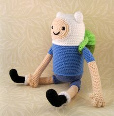 *PLEASE NOTE - THIS LISTING IS FOR A CROCHET PATTERN NOT THE FINISHED ITEM.* With this pattern you can make yourself a little Finn from Adventure Time, with a removable backpack that you can fill with useful items. The pattern is quite straightforward and suitable for