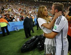 Fifa World Cup 2014 Brazil: GERMAN Celebration: Götze hugs girlfriend Ann Kathrin Brömmel • Germany wins 4th cup (1954+74+90+14)!! Equal to Italy. Only needing to beat one more, Brazil's 5. Germany's Mario Götze made only but beautiful goal in match against Argentina at 113th min in 2nd 1/2 of extra time, avoiding penalties!