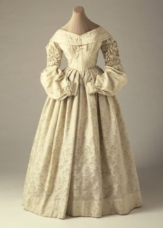 Woman's Dress (Wedding) | LACMA Collections Woman's Dress (Wedding) England, 1837-1838 Costumes; principal attire (entire body) Wool brocaded with silk Costume Council Fund (M.64.85.1) Costume and Textiles Not currently on public view
