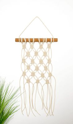 DIY Mini Macrame Wall Hanging: This tutorial uses one basic knot to create a beautiful, minimal macrame wall hanging. Create this piece in under an hour!