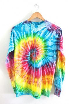 Bright rainbow tie-dyed, cotton long sleeve unisex t-shirt. Please note: Each tie-dyed tee is hand dyed and slightly unique. Washing instructions: Machine wash inside out in very cold water, dry normally. Slight fading may occur. Tie Dye Sweatshirt, Tie Dye Shirts, Tie Dye Long Sleeve, Long Sleeve Shirts, Tie Dye Bedding, Tie Dye Outfits, Lazy Outfits, How To Tie Dye, Tie Dye Designs