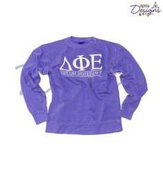 Delta Phi Epsilon purple unisex sweatshirt just in time for all the freezing cold weather! Classic lined design! Only at DPhiE Designs!