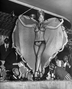Ruth King winning the prize of the most beautiful costume during the Urban League Ball at the Savoy Ballroom in Harlem. New York, February 1949.