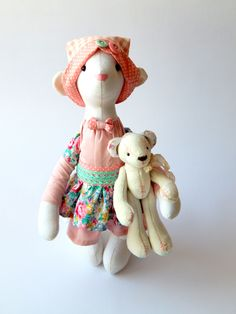 "Toy ""Bear"" is wearing a pink dress, a white undershirt and white pants. There is a blue bow on its head. All clothing - the technological part of the toy and can not be removed. Mouse holds a small beige teddy bear, he sewed plush paws on buttonholes mounts. Its size is only 3 inches. It may be a separate toy."
