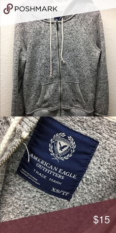 gray american eagle zip up a plain warm gray zip up from american eagle. it's in nice shape nothing wrong with it , just grew out of it ! American Eagle Outfitters Sweaters