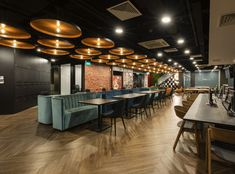 Ong & Ong, an architecture firm that provides urban planning, architecture and landscape services, recently moved into a new office in Singapore, Building Information Modeling, Modus Operandi, Community Space, Banquette Seating, Workplace Design, Break Room, Hotel Lobby, Urban Planning, Textured Walls