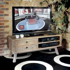 "Designed for a TV 65"" wide the Bainton TV cabinet has a streamlined appearance with beautifully slender angled legs. There's space for a DVD player and digital box in the two open shelves and the unit also has two drawers"