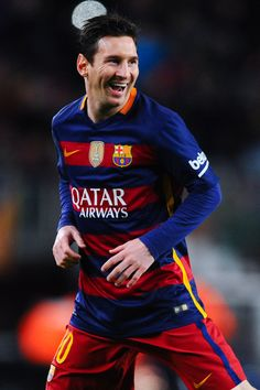 Lionel Messi of FC Barcelona celebrates after scoring the opening goal during the La Liga match between FC Barcelona and Celta Vigo at Camp Nou on February 14, 2016 in Barcelona