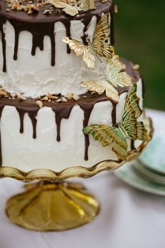 Amazing butterfly details on this wedding cake   Photo by Frenzel Studios