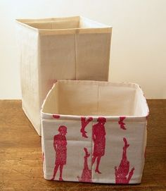 Fabric Storage Boxes (upcycled cardboard inserts)  similar here http://sew4home.com/projects/storage-solutions/370-stylish-baby-nursery-collapsible-storage-baskets