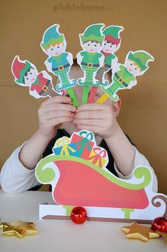 Five Little Elves Song - a Christmas counting song with free printable puppets and sleigh...really cute elf cut outs!!