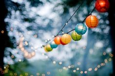 I love these for the balcony!  paper lanterns are so cheap too..instead of lighting them I'll just hang them by wire fishing string