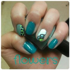 I painted my nails blue with a flower and other designs. These nails are cute and fun