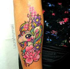 Bold color unicorn tattoo