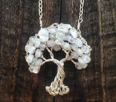 https://flic.kr/p/nrdpWf | Gnarly Tree Necklace | Handcrafted from recycled sterling silver and natural moonstone.  www.ethora.com