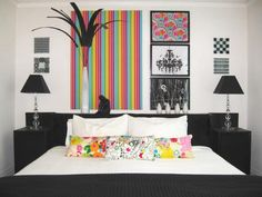 A rainbow of color is the perfect way to make a black-and-white color palette stand out even more. HGTV fan sanfran used color to balance the room, leading the eyes from the pillows on the bed all the way up to the striped print on the wall.