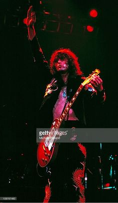 Guitarist Jimmy Page of British rock band Led Zeppelin performing on stage at Earl's Court in London, England in May 1975.