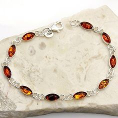 Lovely Sterling Silver Natural Baltic Amber Bracelet  Price : $59.95 http://www.silverplazajewelry.com/Lovely-Sterling-Silver-Natural-Bracelet/dp/B00J0CEQCM