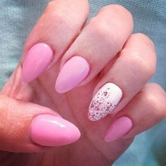 Pink pointy nails with a splash of glitter on white