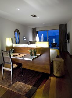 If you lack space this is great idea - have headboard of a bed be the desk - Hotel Fasano Rio de Janeiro