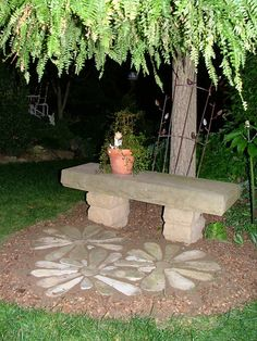 Stone Flowers Garden Art .. how cute would this look with a pot of flowers in the center or moss growing around it