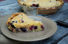 Creamy Blueberry Pie with sour cream custard berries topped with a streusel