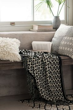 Jacquard-weave blanket: Jacquard-weave blanket in a cotton blend with fringes on the short sides.