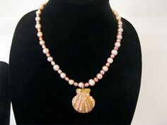 Sea Shell Pendant on a strand of fresh water by MDJewelCraft, $40.00