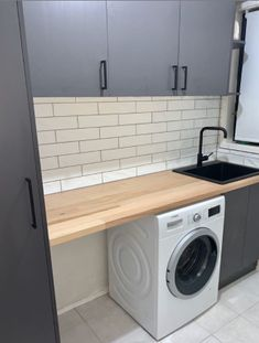 Laundry goals! @mickygooze has transformed a once tired and dated space into a seriously modern and functional laundry, featuring our grey spice doors, which work perfectly with the timber tones!