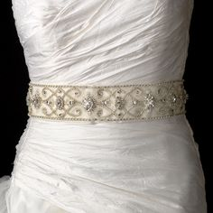 "Stunning Swarovski Crystal, rhinestone and bugle beaded royal bridal belt sash.  Size: Design extends 33 1/2"" long by 2 1/3"" Wide on a 95"" ribbon."