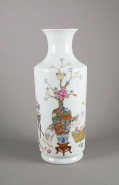 Chinese Famille Rose enameled porcelain vase; ovoid body with broad shoulders featuring Buddhist emblems; six-character Qianlong Mark on base; H: 34 cm, D: 13 cm