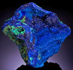"whateveramusesme:  Azurite Azurite owes its name to its beautiful azure-blue color, which makes it a very popular and well-known mineral. It usually occurs with green Malachite, which may form green stains or specks on Azurite crystals or aggregates. The two minerals sometimes occur admixed or banded together, forming what is called ""Azure-malachite"" in the gem and mineral trades."