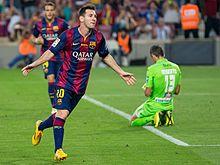 Messi celebrates his second goal against Granada in September 2014.