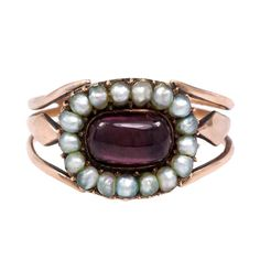 An antique half pearl and garnet cluster ring with openwork shank, in 18kt gold. Inscribed and dated on verso, circa 1799