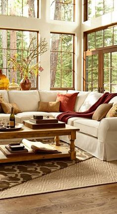 Beautiful, cozy room.  And those windows and all that natural light with a view of the woods!
