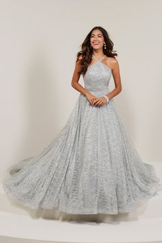 73435070411 Tiffany Designs 16352 Halter neckline with Rhinestone bodice and waistband  and neckline. Gathering sparkle tulle skirt with lace underlay.