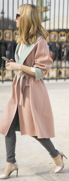 Street style during Paris Fashion Week Spring 2015: a pink wool coat tied at the waist with a contrasting green lapel over grey skinny jeans and silver pointed pumps