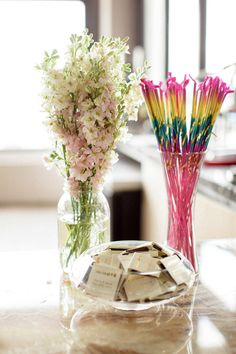 sparklers next to matches in glass container for send off/party favor