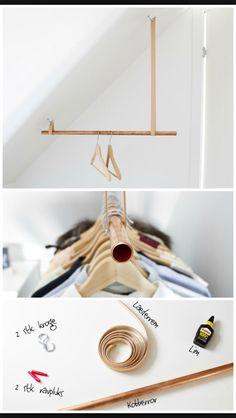 DIY tøjstativ med kobber rør og læderrem.