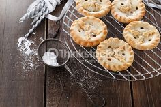 Stock Photo : Christmas fruit mince pies over rustic wooden background