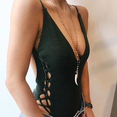 The Blue Life Mermaid One Piece features a military green fabrication with net overlay, lace up sides and adjustable cami straps. This sexy one piece looks great with a high waisted maxi skirt.