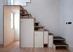 Plywood staircase by Buj+Colón Arquitectos integrates shelving