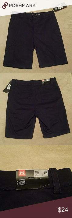 Under Armour Boy Shorts NWT Navy Blue boy shorts- Adjustable waistband- Has a button and zipper- Has Beatloops-Has small Markings around waist from stitching of the adjustable band on inside Under Armour Bottoms Shorts