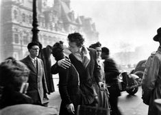 "Taken in front of a Parisian café in Robert Doisneau's most famous photograph, ""Le Baiser de l'Hotel de Ville"" (above) became a symbol of Paris as the ""city of love"" and one of the iconic photographs of the century. The much-loved photographer Robert Doisneau, Vintage Photography, Couple Photography, Street Photography, Famous Photography, Photos Amoureux, Gropius Bau, The Kiss, My Little Paris"