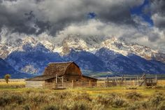 Magical late morning capture of the Moulton historic barn, as the clouds lifted from the majestic Grand Teton Mountains in Wyoming, USA.