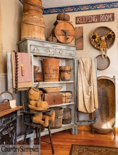 "Lea's knack for combining like items in tightly grouped displays has maximum impact in this dining room corner, where she arranges rustic wooden buckets, boxes and dough bowls of various sizes along the shelves of an open-door pie safe.  To see more of this great home, check out the ""Primitive In Progress"" article in our September  2020 issue.   Photographed and styled by Gridley + Graves Photographers Country Crafts, Country Decor, Country Life, Prim Decor, Rustic Decor, Primitive Bedroom, Primitive Country, Dining Room Corner, Country Sampler Magazine"