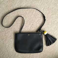 Tory Burch tassel bag & clutch Tassel bag with removable Crossbody strap so you can use as a clutch as well. Brand new, never used & in perfect condition. Comes with tags. Tory Burch Bags