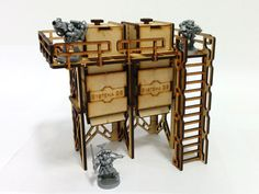 A review of the Base-0Level Storage Silo kit from Systema Gaming, laser-cut MDF terrain compatible with wargames such as Warhammer 40k and Infinity.