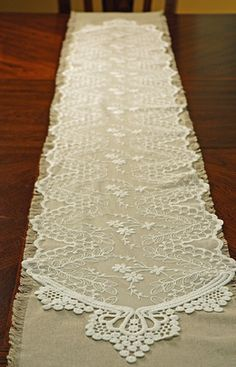 Add a touch of romance to your head table with this Embroidered Tulle Table Runner White 12in x 74in (Save 33%) - pair it over a burlap runner shown here and I'm in love!